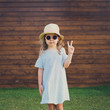 cute girl sunglasses making peace sign