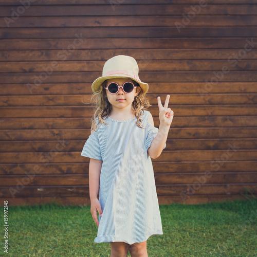 cute girl sunglasses making peace sign