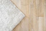Laminate parquete floor. Light wooden texture. Beige soft carpet. Warm interior design - 159980714