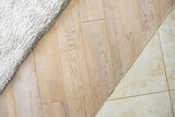 Laminate parquete floor.  Beige soft carpet. Marble tile. Warm interior design - 159980777