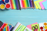 school and office supplies. school background. colored pencils, pen, pains, paper for  school and student education on blue wood background. top view with copy space - 159981196