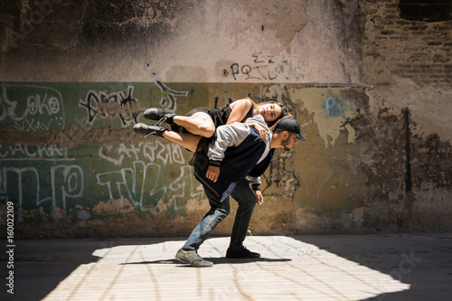 Female dancer on top of her partner Poster