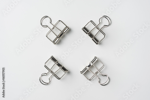 Top view of empty silver clip on white background desk for mockup, collection of diverse angle Poster