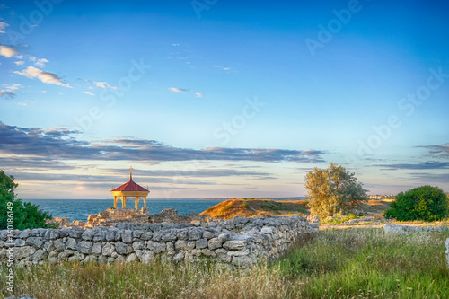 Marine landscape with views of the ruins of the ancient city of Hersonissos on the background