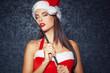 Sexy sensual santa girl posing with whip at vintage wall