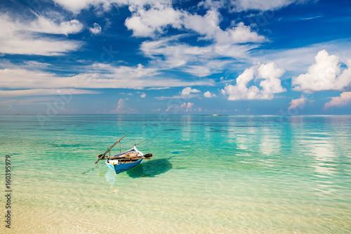 Beautiful ocean beach and boat on Maldives