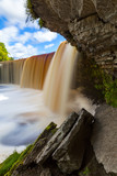 Jagala is the biggest waterfall in Estonia. Long exposure day shot. Close up. Water is red due to swamp organics.