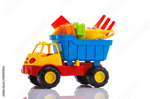Baby beach sand toys and colorful plastic truck isolated