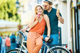 Happy Couple Riding a Bike - 160460328