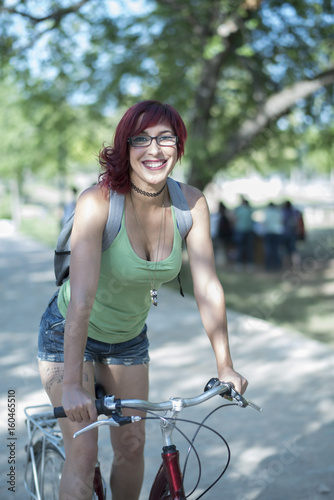 Sexy young woman on bike in outdoors image in a park