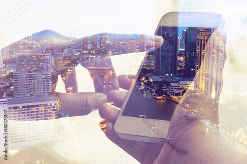 Double exposure image of people with smart phone and cityscape background,Business technology concept. - 160478157