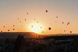 Many hot air balloons flying over Cappadocia at sunrise. - 160481599