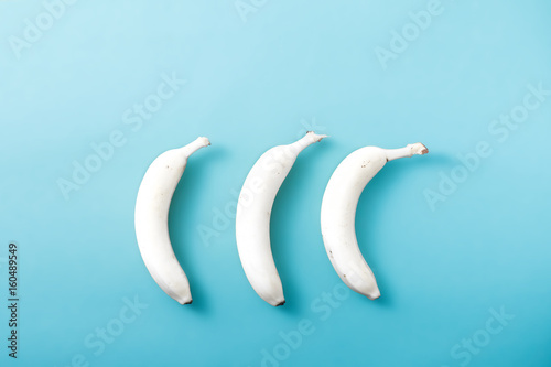 White banana on pastel blue background. Minimal fashion, flatlay , top view. Albino Different Creativity Creative Thinking Ideas Concept - 160489549