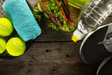 Healthy Life Sport Concept. Sport Towel, Water, Healthy Sandwich on Wooden Background. Copy Space. Top View.