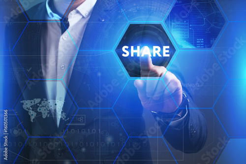 Business, Technology, Internet and network concept. Young businessman working on a virtual screen of the future and sees the inscription: Share