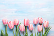 Pink tulips on blue wooden table