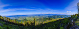 Mountain summer panorama landscape. Beskidy mountain in southern Poland. View at Żywiec, Żywieckie Lake and Babia Góra.