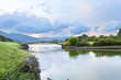 small bridge in golf course green grass field  and lagoon.