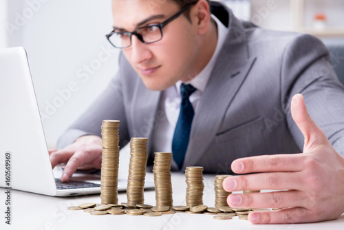 Businessman with golden coins in business growth concept - 160569969
