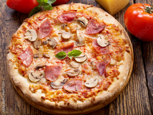 pizza with ham, salami and mushrooms