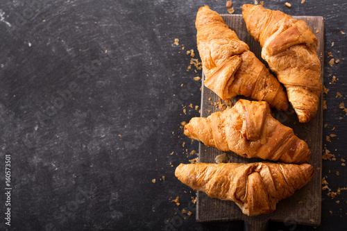 fresh croissants on a wooden board
