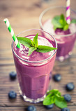 Fresh blueberry smoothie in the glass