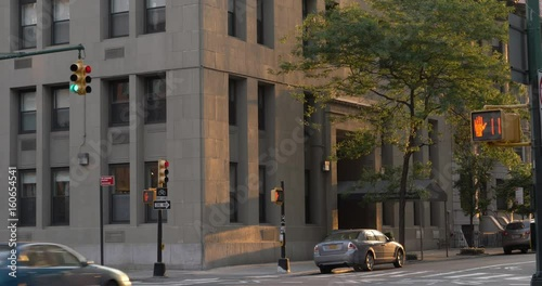 An evening establishing shot of a corner apartment or office building in downtown Brooklyn, New York