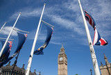 england flags in the wind in front of Big Ben, London, UK - 160664741