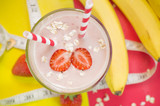 Milkshake with banana, strawberry and oat. Useful smoothies. Top view.