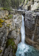 Waterfall over a Rock Cliff in the Canadian Rocky Mountains