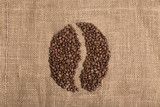 Coffee grain from coffee beans on textured brown background
