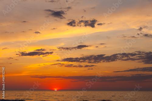 Poster Oranje eclat Idyllic shot of sunset by the sea