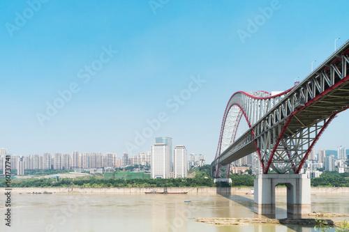 steel bridge over river in modern city