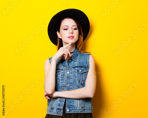 Foto Murales Portrait of young adult woman in hat
