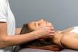 Leinwanddruck Bild - Little girl having osteopathic jaw treatment.