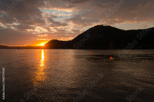 rays of sunshine on the beach by the river in summer morning Poster