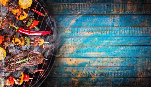 Barbecue grill with beef steaks, close-up. - 160808547