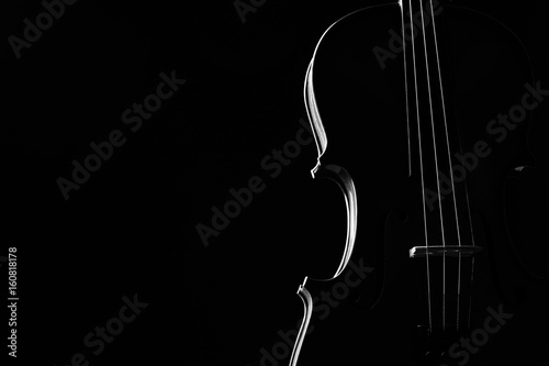 Violin classical music instrument close-up. Stringed musical instrument violin isolated on black background with copy space. Classical orchestra instruments fiddle close up - 160818178