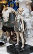 Vintage girl figurine at flea market in Paris (France)