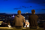 'Masters of the world': Two young men staring at sunset over Barcelona