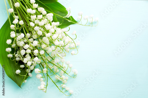 Fotobehang Lelietjes van dalen Bouquet of fresh white lilies of the valley in a wooden window still. Top view
