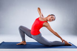 Yoga concept, Pretty sporty indian woman smiling in doing yoga on concrete background.
