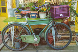 Vintage bicycle with table and garden plants in Amsterdam