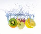 fruits splashing in water