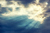 Fototapety Beautiful dramatic sunset cloudy sky with sun rays. Natural background and texture, abstract image