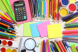 school and office supplies. school background. colored pencils, pen, pains, paper for  school and student education on blue wood background. top view with copy space - 160865934