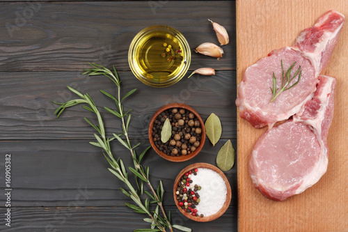 fresh raw meat with spices on wooden table. top view with copy space - 160905382