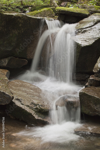 Beautiful waterfall with moss on the stones in the woods. - 160941766