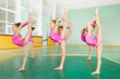 Preteen girls practicing gymnastics in sports hall