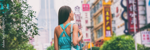 Deurstickers Shanghai Asia city travel lifestyle banner. Tourist woman walking on Nanjing Road shopping street, Shanghai city, China, . Asian girl on urban adventure, famous chinese attraction landmark.